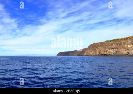 Rocky cliffs on the shore on the coast of La Gomera Island, Canary Islands, Spain