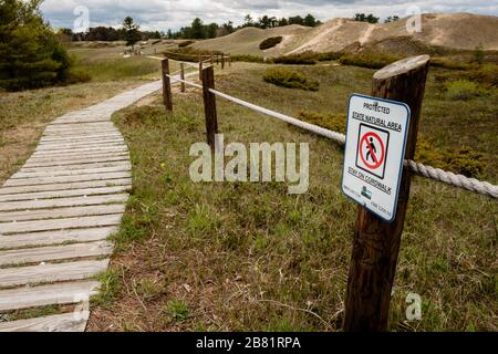 Protecting the sand dunes at Kohler-Andrae State Park, Sheboygan, Wisconsin, requesting everyone to stay on the cordwalk - Stock Photo