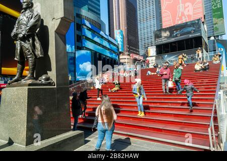 The red steps in Times Square in New York is unusually uncrowded due to the social distancing imposed by the COVID-19 pandemic, seen on Sunday, March 15, 2020.  (© Richard B. Levine) - Stock Photo