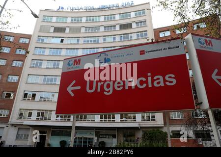 Madrid, Spain. 19th Mar, 2020. People walk outside the Jimenez Diaz Hospital in Madrid, Spain, 19 March 2020, where allegedly former Madrid Regional President Esperanza Aguirre and husband Fernando Ramirez have checked in for coronavirus. Credit: JUANJO MARTIN/EFE/Alamy Live News Stock Photo