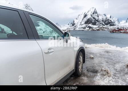 Traveler car parking to visit Reine view point in Lofotten - Stock Photo