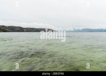 Lake Tota, Boyaca / Colombia: April 7, 2018: landscape of the largest lake in Colombia, a cold and cloudy afternoon - Stock Photo