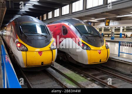 Two Virgin Class 390, Pendolino, electric tilting trains at Euston Railway Station, London, England - Stock Photo