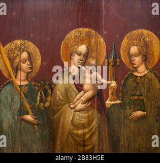 Virgin Mary with Infant Jesus with Saint Margaret of Antioch and Saint Barbara. c. 1420–30. Part of a Gothic altar. Bratislava City Gallery. - Stock Photo