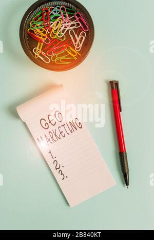 Conceptual hand writing showing Geo Marketing. Concept meaning the geolocated marketing techniques to get new clients Notebook and stationary with mou - Stock Photo
