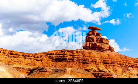 The sombrero-shaped rock outcropping on the northeast edge of the town named Mexican Hat, Utah, USA