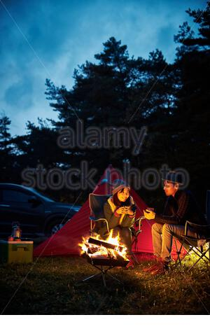 A couple chatting with - Stock Photo
