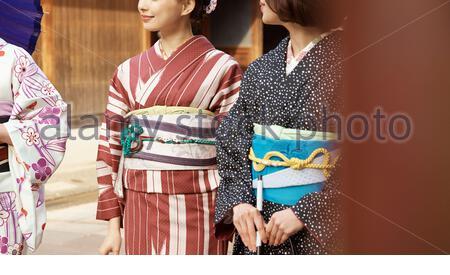 Women sightseeing by kimono - Stock Photo