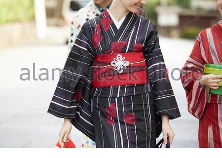 Foreign women traveling in the ancient capital and Japanese women - Stock Photo