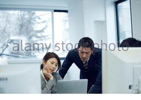 Gender seeing a PC - Stock Photo