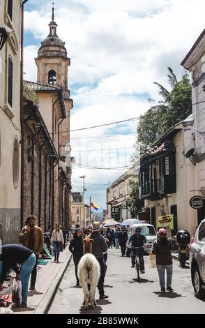 Hustle and Bustle in one of the busiest streets leading to Plaza Bolivar in La Candelaria old town district of Bogota, Colombia