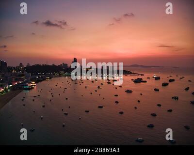 Aerial View Sunset With Drone. Tourists at Pattaya Beach, Chonburi, Thailand. Beautiful landscape Hat Pattaya Beach.