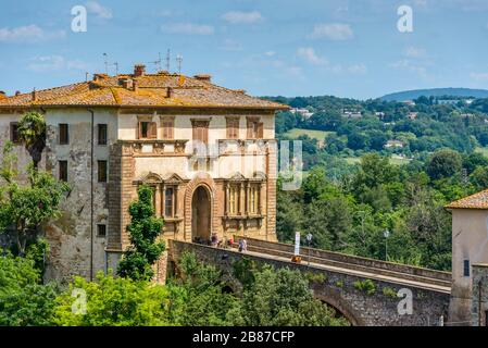 Colle di Val d'Elsa, Tuscany / Italy: The Campana Palace (Palazzo Campana) gate into the old town - Tuscan mannerist architecture of the 16th century. - Stock Photo