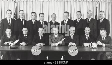 Astronaut Groups 1 and 2. The original seven Mercury astronauts selected by NASA in April 1959, are seated (left to right): L. Gordon Cooper Jr., Virgil I. Grissom, M. Scott Carpenter, Water M. Schirra Jr., John H. Glenn Jr., Alan B. Shepard Jr., and Donald K. Slayton. The second group of NASA astronauts, which were named in September, 1962, are standing (left to right): Edward H. White II, James A. McDivitt, John W. Young, Elliot M. See Jr., Charles Conrad Jr., Frank Borman, Neil A. Armstrong, Thomas P. Stafford, and James A. Lovell Jr. - Stock Photo
