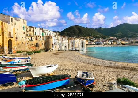Traditional Cefalu' famous illage,view with colorful houses,sea and mountains,Sicily,Italy. - Stock Photo