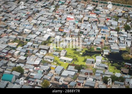 Cape Town, South Africa - December 1, 2019 - aerial view of flooded shacks in informal settlement area