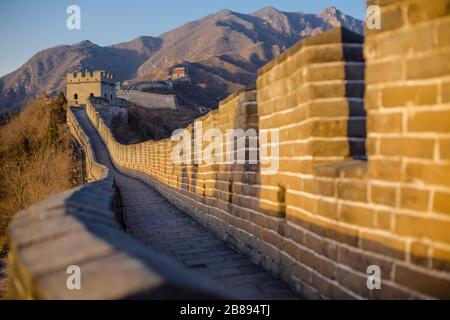 Sun sets on a blue sky day at the Great Wall of China, Beijing, China - Stock Photo
