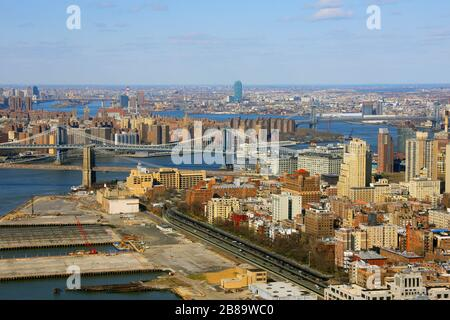 New York districts Manhattan, Brooklyn and Queens at East River with the bridges Brooklyn Bridge, Manhattan Bridge and Williamsburg Bridge, 12.04.2009, aerial view, USA, New York City - Stock Photo