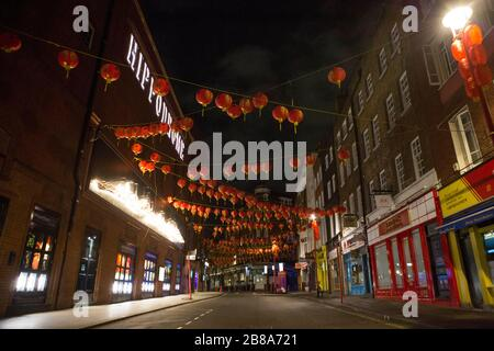 London, UK. 21st March 2020. Empty streets of Chinatown just after midnight on Saturday.  The government advises staying at home and limiting social life. - Stock Photo