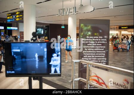 18.03.2020, Singapore, Republic of Singapore, Asia - Automated body temperature screening to detect a potential fever, before people can enter Jewel. - Stock Photo