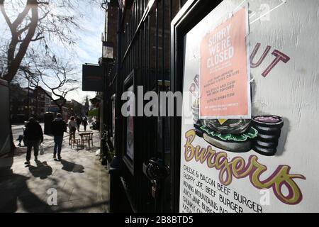 A closed closed Vineyard pub on Upper Street, Islington, London, as the Prime Minister Boris Johnson told restaurants, cafes, pubs, bars, gyms and leisure centres to close whilst pleading the public to stay at home. Picture date Saturday 21st March 2020. See PA story HEALTH Coronavirus. Photo credit should read: Jonathan Brady/PA Wire - Stock Photo