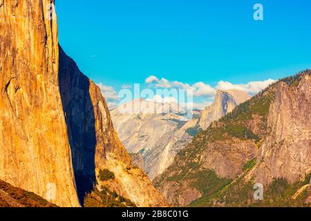 Tunnel View with El Capitan and Half Dome in Yosemite National Park around sunset - Stock Photo