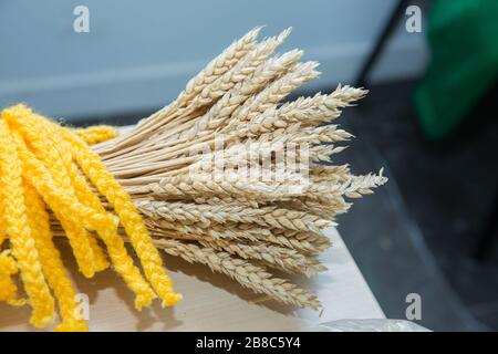 Decorative bouquet of dry rye ears. Secale cereale. Idea of farming, agronomy . Dry yellow rye spikes Secale cereale , Studio shot. - Stock Photo