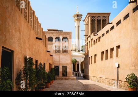 Old Dubai view with mosque, buildings and traditional Arabian street. Historical Al Fahidi neighbourhood, Al Bastakiya. Heritage district in United Ar - Stock Photo