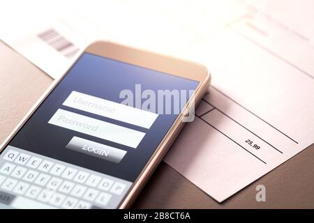 Phone bill and smartphone with online bank app. Electricity, energy, utilities or gas invoice on table with mobile smart device for internet payment. - Stock Photo