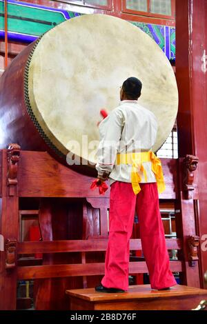 Beijing, China-October 2019; Drummer performance at the drum tower in Beijing only to be reached after climbing 70 steep stairs on a continuous stairc - Stock Photo