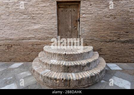 wooden door and stairs on a typical building on the street of the old town Itchan-Kala, Khiva, Uzbekistan, Central Asia - Stock Photo