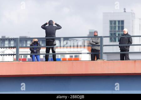 A man who threatened to throw himself off a bridge in Leeds, is seen speaking to negotiators, who managed to talk him to safety after 4 hours - Stock Photo