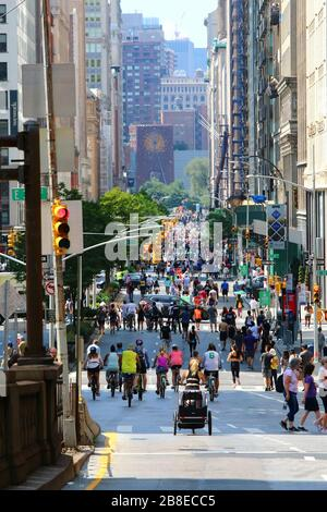 Crowds of runners, cyclists, and pedestrians enjoy retaking Park Avenue in Midtown during Summer Streets festival, Manhattan on AUGUST 3rd, 2019 in Ne - Stock Photo