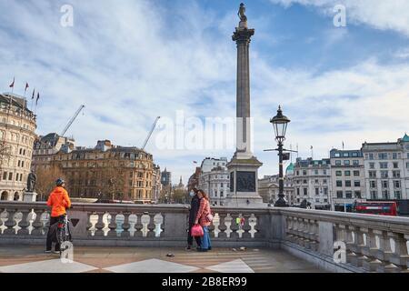 March 21st, 2020 -Trafalgar Square, London, England: Tourist numbers dwindle at Trafalgar Square during the Coronavirus pandemic - Stock Photo