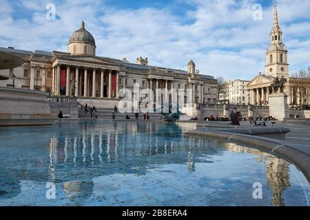 March 21st, 2020 -Trafalgar Square, London, England: Tourist numbers dwindle at Trafalgar Square during the Coronavirus pandemic - Stock Photo