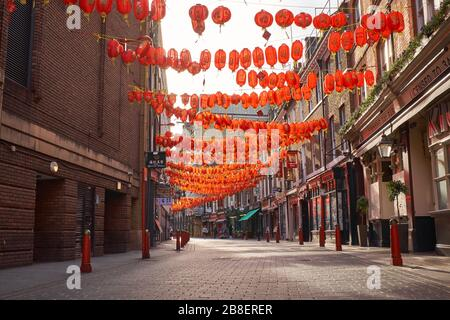 March 21st, 2020-Soho, London, England: Chinatown is almost deserted during the Coronavirus pandemic - Stock Photo