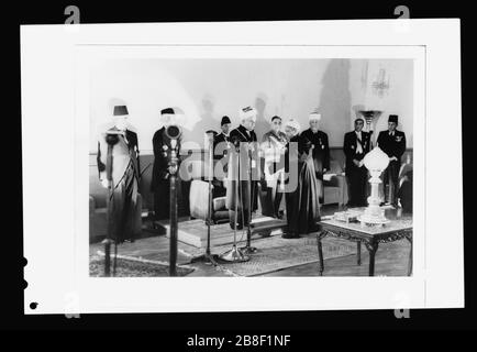 'English: Title: 'Coronation' of King Abdullah in Amman on May 25, '46. Sheik handing King Abdullah proclamation of the crowning Abstract/medium: G. Eric and Edith Matson Photograph Collection  Physical description: 1 negative :; Library of Congress Catalog: https://www.loc.gov/pictures/collection/matpc/item/mpc2010007705/PP Original url: https://hdl.loc.gov/loc.pnp/matpc.22545; Matson Collection; ' - Stock Photo