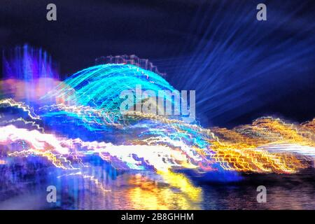 Sydney Harbour Bridge illuminated and abstracted during VIVID Sydney, the popular annual event of light sculptures and creative illuminated art - Stock Photo