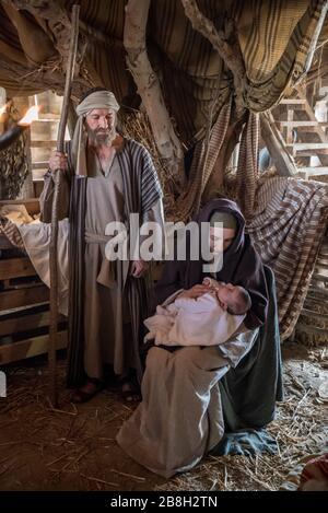 Live Nativity Scene with Saint Joseph, Saint Mary and Baby Jesus - Stock Photo