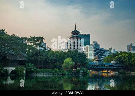 Full size replica of Dong Minority wind and rain bridge along with a Dong Tower at the China Folk Cultural Village, part of Splendid China in Shenzhen - Stock Photo