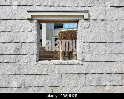 Small window in stone wall - Stock Photo