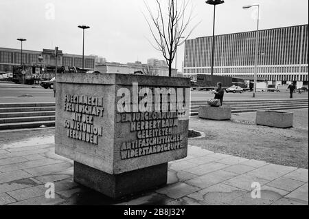 A carved dedication stone celebrating the links between the GDR and the Societ Union, in the former East Berlin, pictured after the fall of the Berlin Wall. The Berlin Wall was a barrier constructed by the German Democratic Republic (GDR, East Germany) starting on 13 August 1961, that completely cut off West Berlin from surrounding East Germany and from East Berlin. The Wall was opened on 9. November 1989 allowing free movement of people from east to west. - Stock Photo