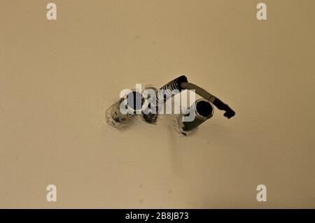 Plastic plant pipes in the wall (Pesaro, Italy, Europe) - Stock Photo