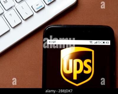 In This Photo Illustration United Parcel Service Inc Ups Logo Is Seen Displayed On A Smartphone Stock Photo Alamy
