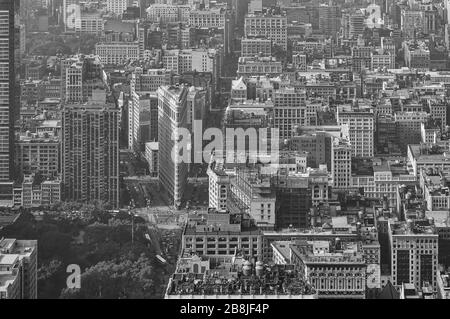 The popular flatiron buliding in New York with the impressive view from above as a black and white image, - Stock Photo