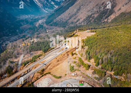Aerial image of Bridge Mont Bardon (Ponte Mont Bardon) with tunnels and highway  n Aosta Valley at the time of corona virus outbreak, northern Italy - Stock Photo
