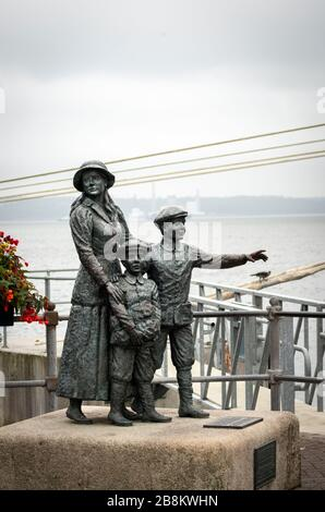 Statue of Annie Moore or Anna Moore as the first woman immigrant in America or US to pass through the Ellis Island at Cobh harbor County Cork Ireland