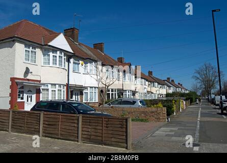 terraced 1930s houses in isleworth, middlesex, england, with bay windows and pebble dashed exteriors - Stock Photo