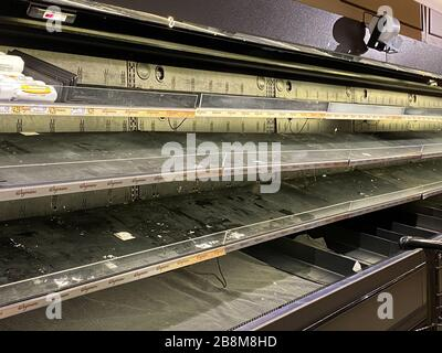 WOODBRIDGE, NEW JERSEY / USA - March 13, 2020: The meat and poultry displays are empty at a local grocery store due to Coronavirus panic buying - Stock Photo