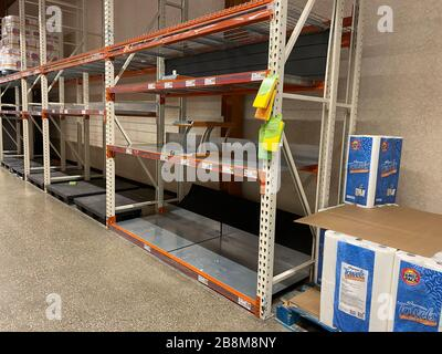 WOODBRIDGE, NEW JERSEY / USA - March 13, 2020: The toilet paper and paper towel displays are nearly completely emptry due to Coronavirus panic shoppin - Stock Photo